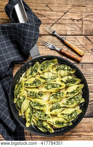 Jumbo Shells Pasta Conchiglioni Stuffed With Spinach And Cheese Baked With Sauce In A Pan. Wooden Ba