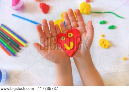 Child Playing With Plasticine, Colorful Modeling Clay And Sculpting Heart . Home Education Game With