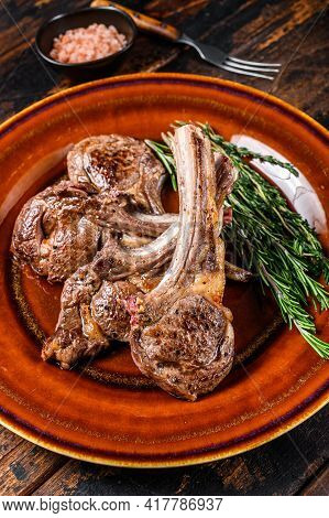 Bbq Grilled Lamb Mutton Meat Chops Steaks On A Plate. Dark Wooden Background. Top View