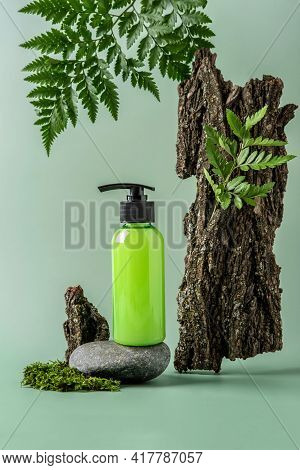 Bottle With Dispenser On Stoun Podium And Pastel Background. Cosmetic Container Mockup With Place Fo