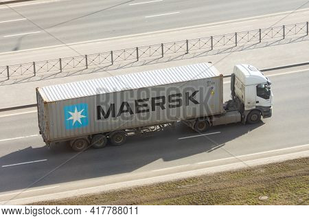Truck With Trailer And Green Container Company Maersk On City Highway. Russia, Saint-petersburg. 15