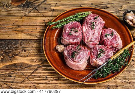 Mutton Lamb Neck Meat On A Rustic Plate With Thyme And Rosemary. Wooden Background. Top View. Copy S