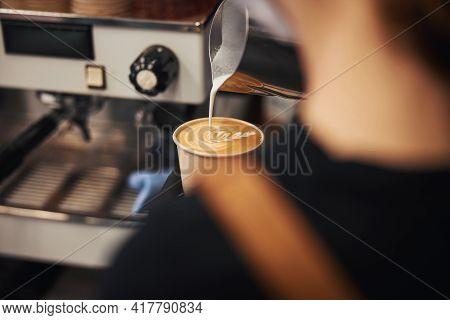 Skillful Barista Making A Leaf Design On Latte Surface