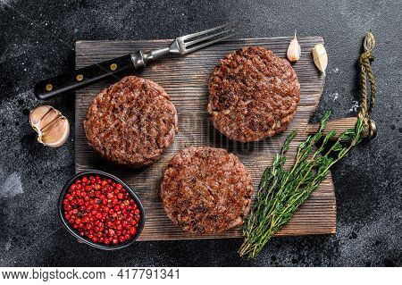 Bbq Grilled Beef Meat Patties For Burger From Mince Meat And Herbs On A Wooden Board. Black Backgrou