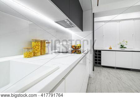 Luxury large modern white and black kitchen interior used as showcase
