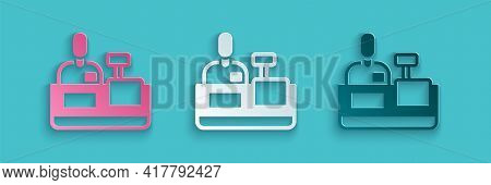 Paper Cut Cashier At Cash Register Supermarket Icon Isolated On Blue Background. Shop Assistant, Cas