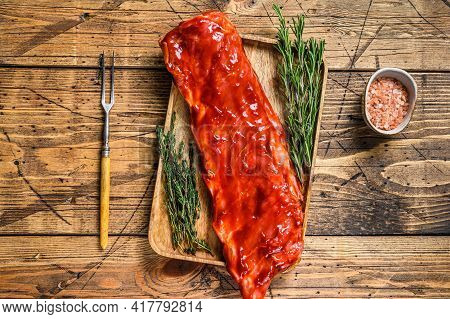 Marinated In Bbq Sauce Veal Brisket Meat On Short Spare Rib On Wooden Tray. Wooden Background. Top V