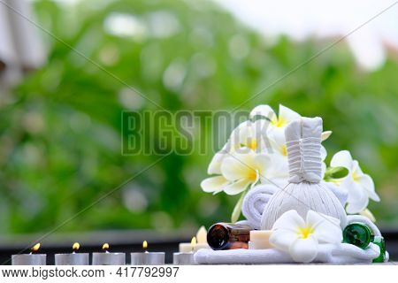 White Towel With Candles On Wooden Background. Massage Setting Lit By Candles. Massage Therapy With