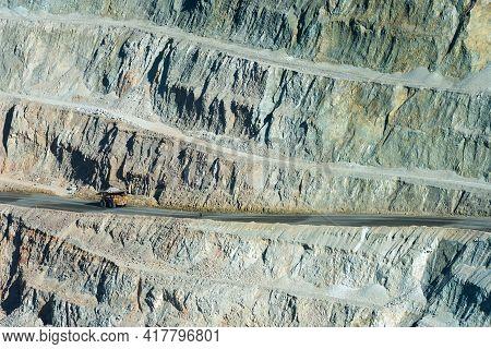 A Huge Dump Truck In A Dirt Road On The Pit Of A Copper Mine In Peru
