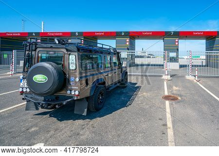 Hirsthals, Denmark - 06.10.2017: Big Offroad Vehicle Waiting In Front Of A Gate In Port To Enter A S