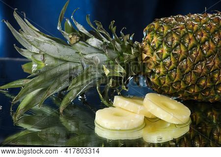 Big Fresh Pineapple Close Up On A Water Drops With Small Pineapple Slices. Water Splash . Multivitam