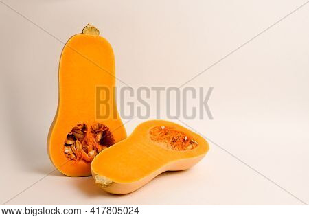 Cut In Half Butternut Squash Isolated On White Background. Healthy Food.vegeterian Concept.vitamin C