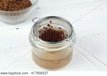 Making Natural Hair Setting Lotion For Perfect Hair. Boiled Flax Seeds Filtered Into A Jar. Organic