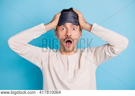 Portrait Of Nice Worried Overwhelmed Brunet Guy Wearing Eye Mask News Reaction Isolated Over Bright