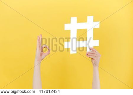 Close Up Of Unrecognizable Female Holding Large Big Hashtag Sign And Showing Okay Gesture, Viral Web