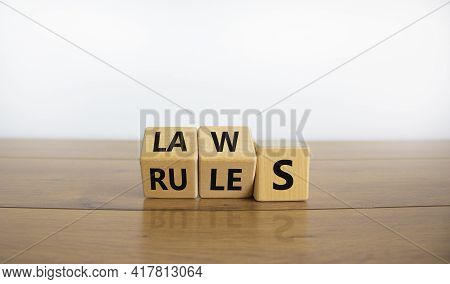 Laws Or Rules Symbol. Turned Cubes And Changed The Word 'rules' To 'laws'. Beautiful Wooden Table, W