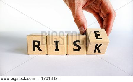 Risk Vs Rise Symbol. Businessman Turns A Wooden Cube And Changes The Word Risk To Rise. Beautiful Wh