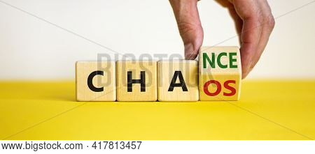 Chance Or Chaos Symbol. Businessman Turns A Cube And Changes The Word 'chaos' To 'chance'. Beautiful