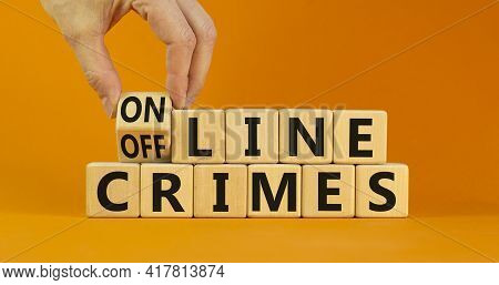 From Offline To Online Crimes. Businessman Turns A Cube And Changes The Words 'offline Crimes' To 'o