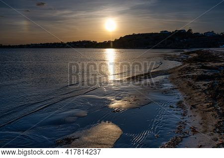 A Beautiful Orange Sunset Over An Ocean Bay. Thee Sun Reflects In The Water. Picture From The Swedis