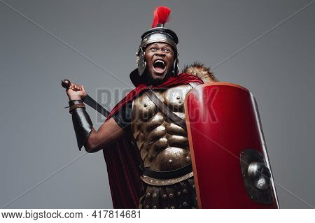 Violent Roman Warrior In Fight Pose With Sword