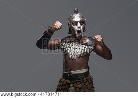 Fearless And Unarmed Gladiator Against Gray Background