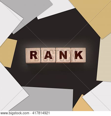 Rank Text On A Black Background On Wooden Cubes. Ranking Seo Concept.