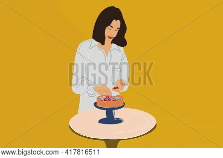 Woman In Blue Shirt Decorate A Cheesecake With Raspberry On The Blue Cake Stands. Home Made Confecti