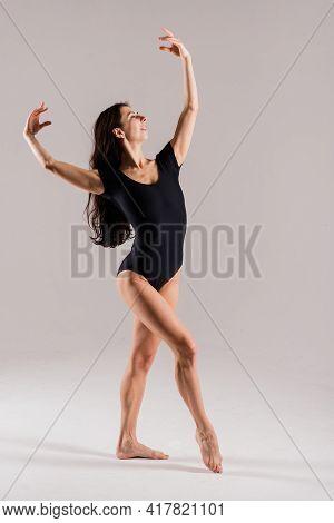 Flexible Female In Black Bodysuits, Ballet Dancer, White Studio Shot