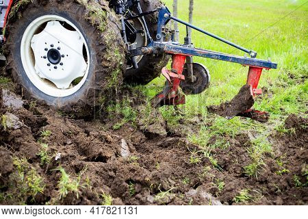 Clods Of Freshly Plowed Fertile Soil. Natural Background Of Brown Raw Earth.