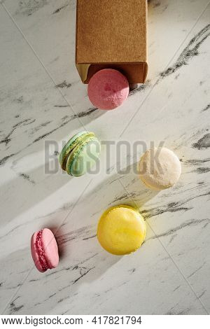 The Macaroons Fell Out Of The Paper Bag Onto The Table.top View