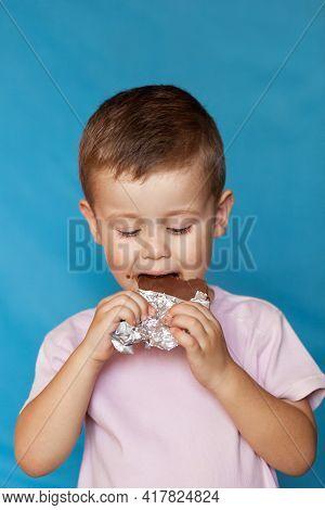 Happy Boy With Chocolate Bar. Cute Little Boy Eating Chocolate Bar. Very Cute Kid With Chocolate, Is