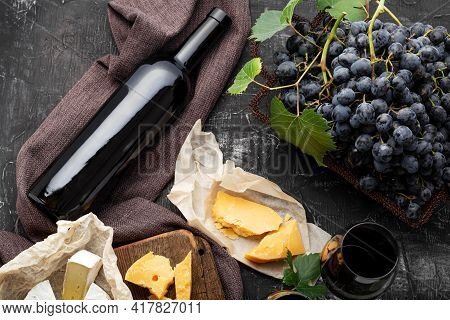Red Wine Bottle Different Cheeses Grapes. Vintage Still Life Wine Composition With Camembert Aged Ch