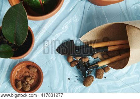 Scattered Expanded Clay For Plants With A Set Of Garden Tools, Wrapped In Craft Paper On A Transpare