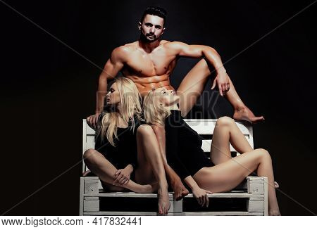 Threesome Lovers. Man With Muscular Wet Body And Strong Athletic Torso With Sexy Blonde Twin Girls I