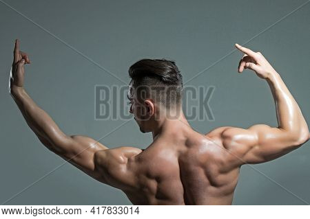 Sexy Muscular Men With Bare Naked Body Torso. Muscular Man With Muscle Torso With Raised Hands In St