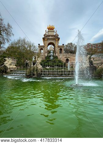 Barcelona, Spain, 10 March 2020 - Pond And Fountain Cascades With Stone Arch, Staircases And Golden