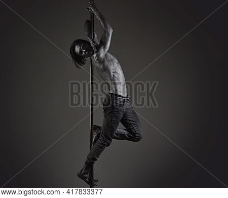 Pole Dancer Man. Sexy Muscular Men With Bare Naked Body Torso. Pole Dancing Guy Makes Figure On Pole