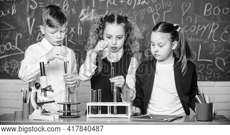 Pupils Study Chemistry In School. Kids Enjoy Chemical Experiment. Chemical Substance Dissolves In An