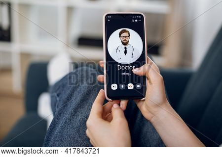 Telemedicine, Stay At Home, Quarantine And Isolation Concept. Video Call To Doctor On Smartphone. Cl