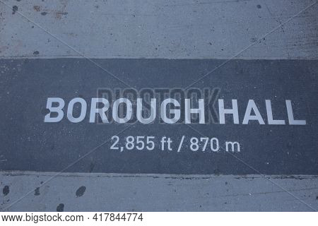 New York City, Ny, Usa 2.09.2020 - Distance Sign To Borough Hall On Dirty Concrete In Brooklyn. New