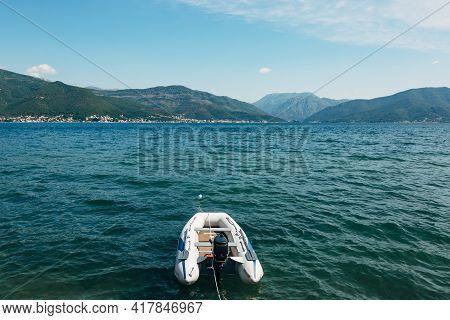 White Inflatable Motor Boat On The Background Of The Kotor Bay And Green Mountains