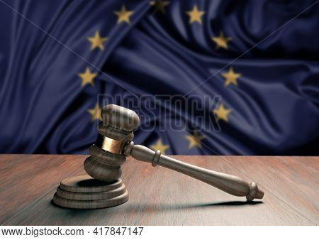 Judge Gavel And Blur European Union Flag In The Background. Law, Legislation And Justice Concept. 3d