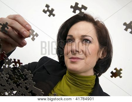 Woman Working A Jigsaw Puzzle
