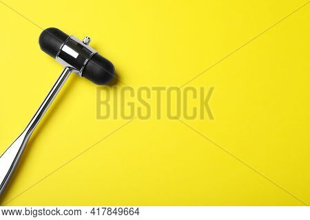 Reflex Hammer On Yellow Background, Top View With Space For Text. Nervous System Diagnostic