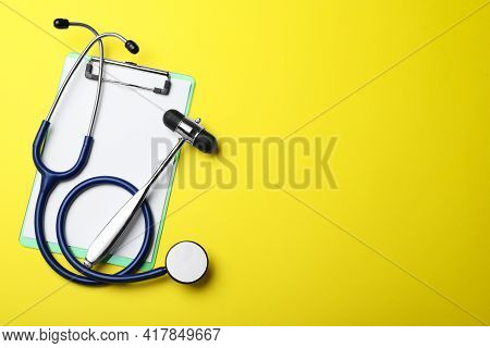 Reflex Hammer, Stethoscope And Clipboard On Yellow Background, Flat Lay With Space For Text. Nervous