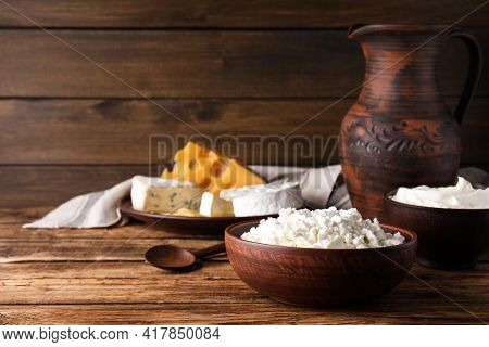 Clay Dishware With Dairy Products On Wooden Table. Space For Text