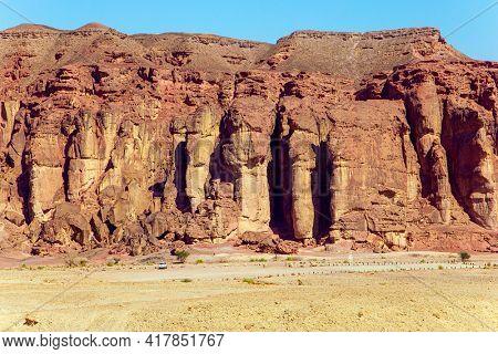 The Timna Valley in the south of the Arava Desert, near the resort of Eilat. Solomon pillars of Timna park. Sandstone rocks. Israel. Hot November day.