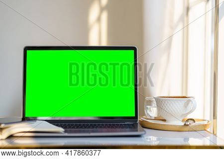 Mockup Of Laptop Computer With Empty Screen With Notebook,coffee Cup And Smartphone On Table Side Th