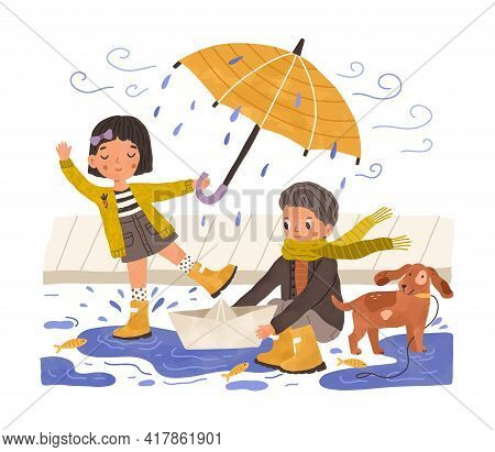 Kids In Gumboots Playing Under Rain. Happy Cute Children With Paper Boat And Umbrella In Rainy Weath